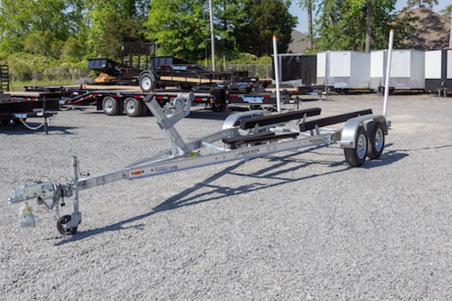 A LoadRite boat trailer in a parking lot