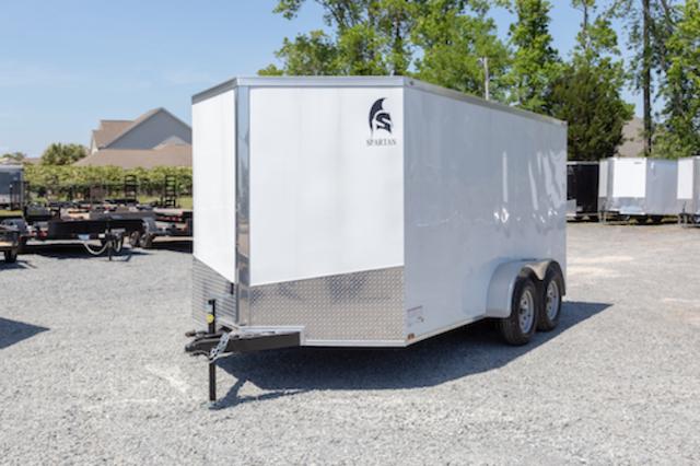 A white SPARTAN 7X14TA enclosed trailer