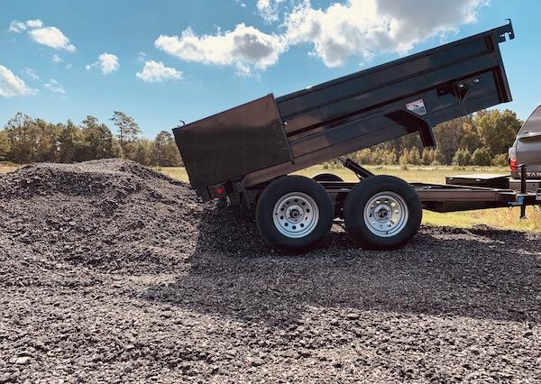 black-dump-trailer-gravel-pile